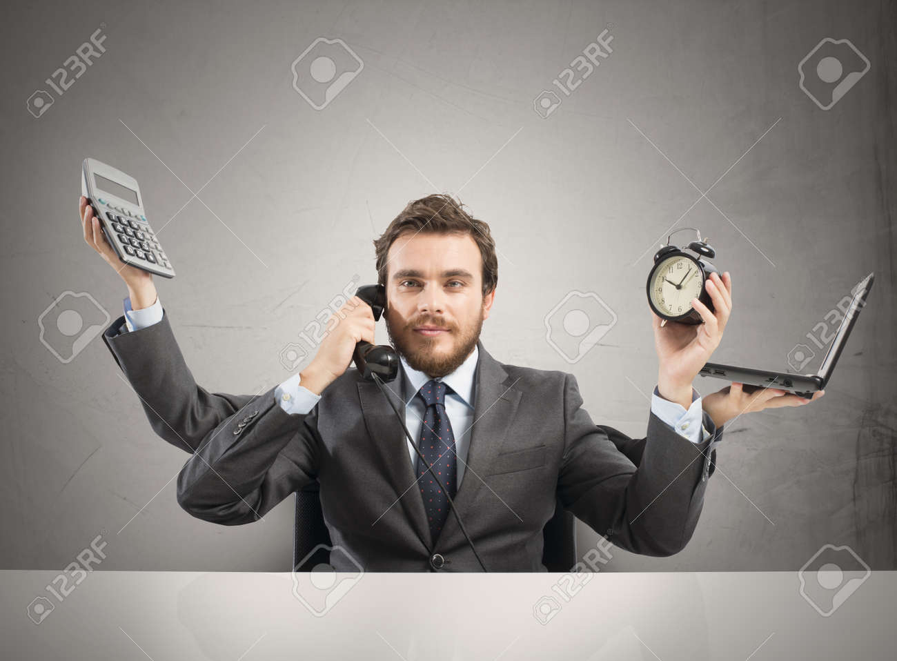 Concept of multitasking businessman who works with more arms - 22935934