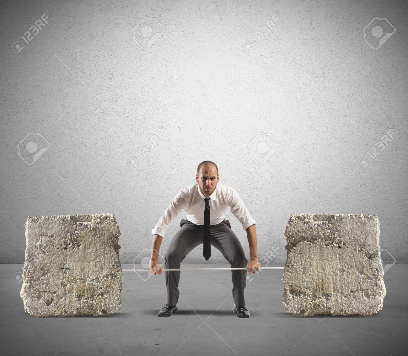 Athlete business man with barbell and heavy stones Stock Photo - 23048258