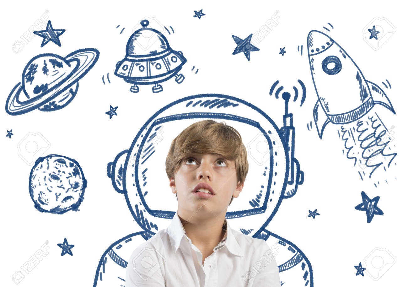 Child who dreams of being in space with open eyes Stock Photo - 24261017