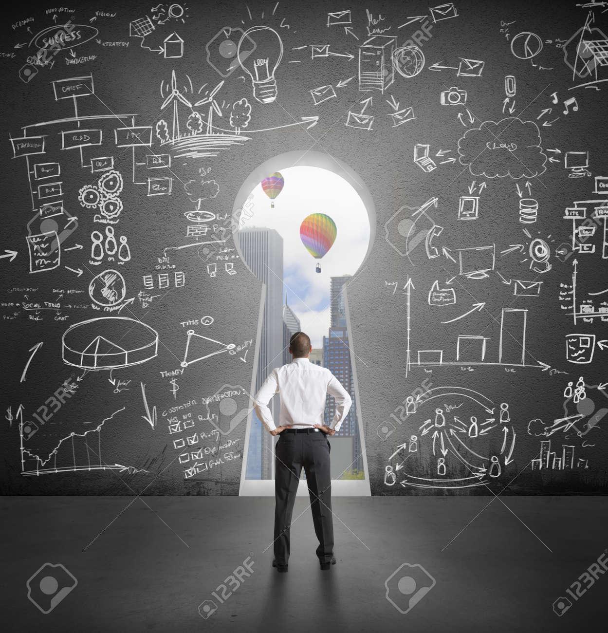 Successful businessman looking the future through key hole Stock Photo - 24488063