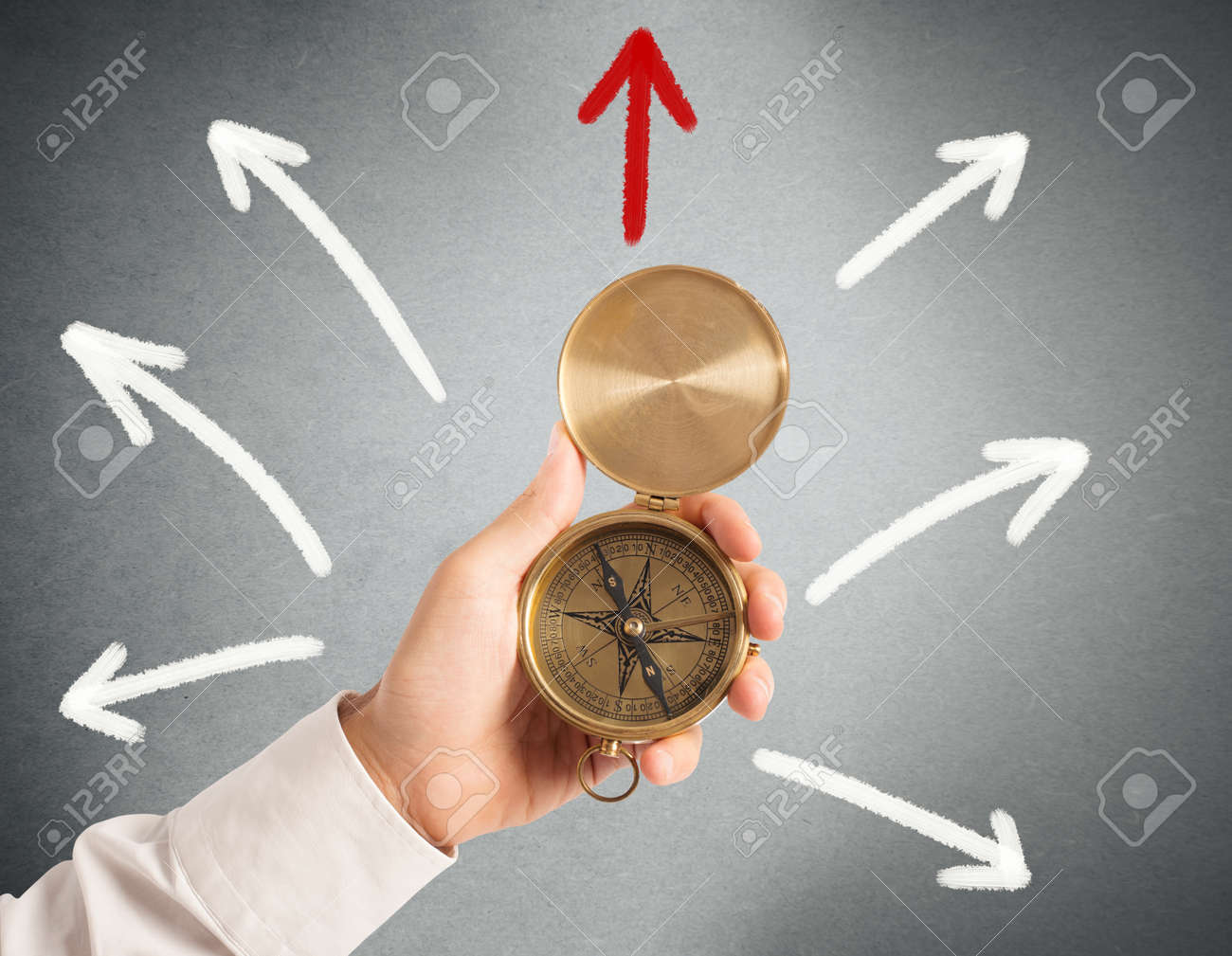Businessman with compass looking for the correct way Stock Photo - 27014280
