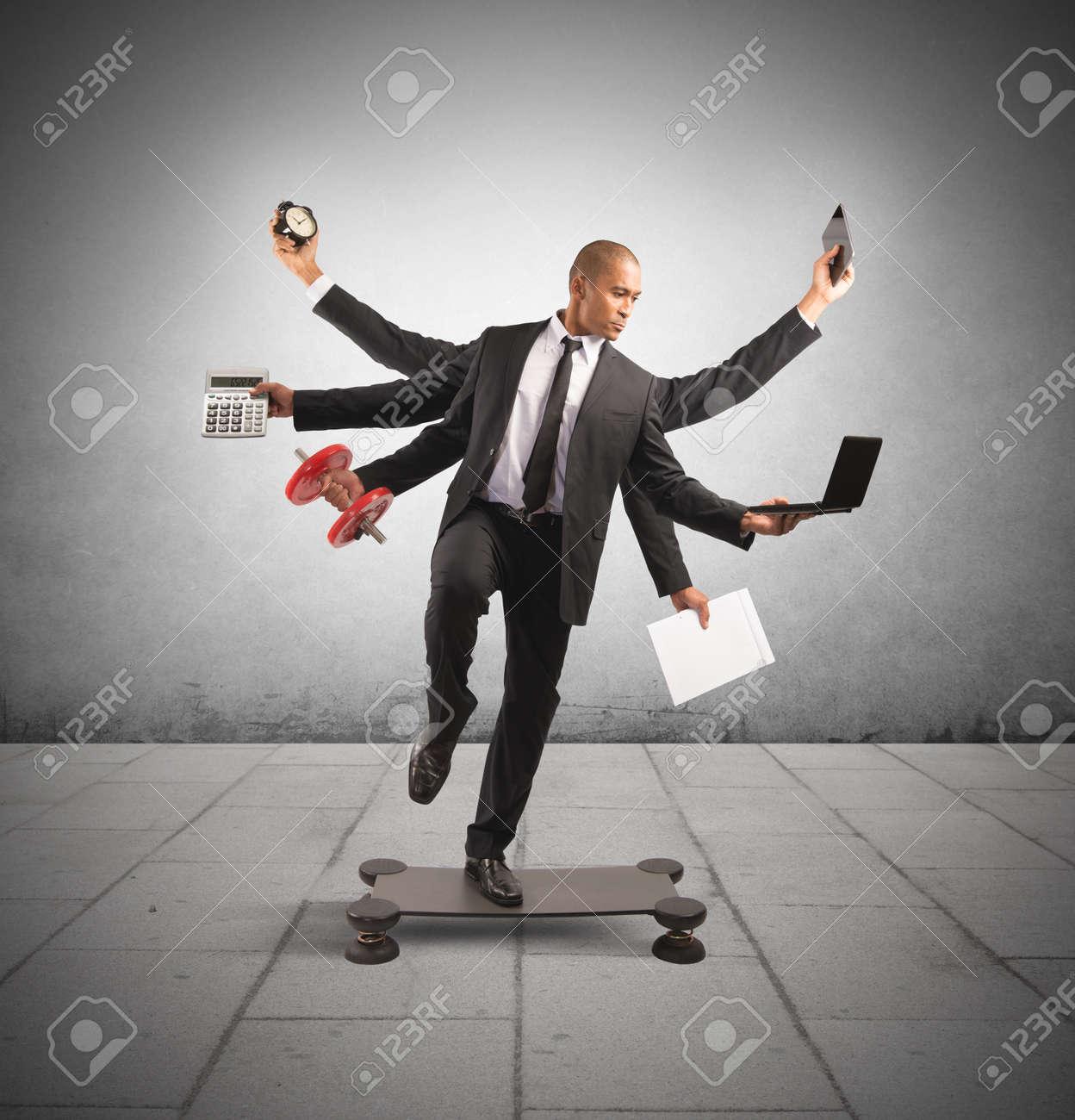 Multitasking concept with businessman at work doing gymnastics - 27430415