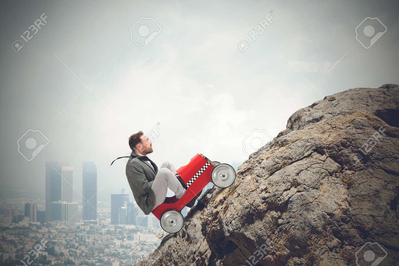 Businessman driving a fast car in a mountain - 32075725
