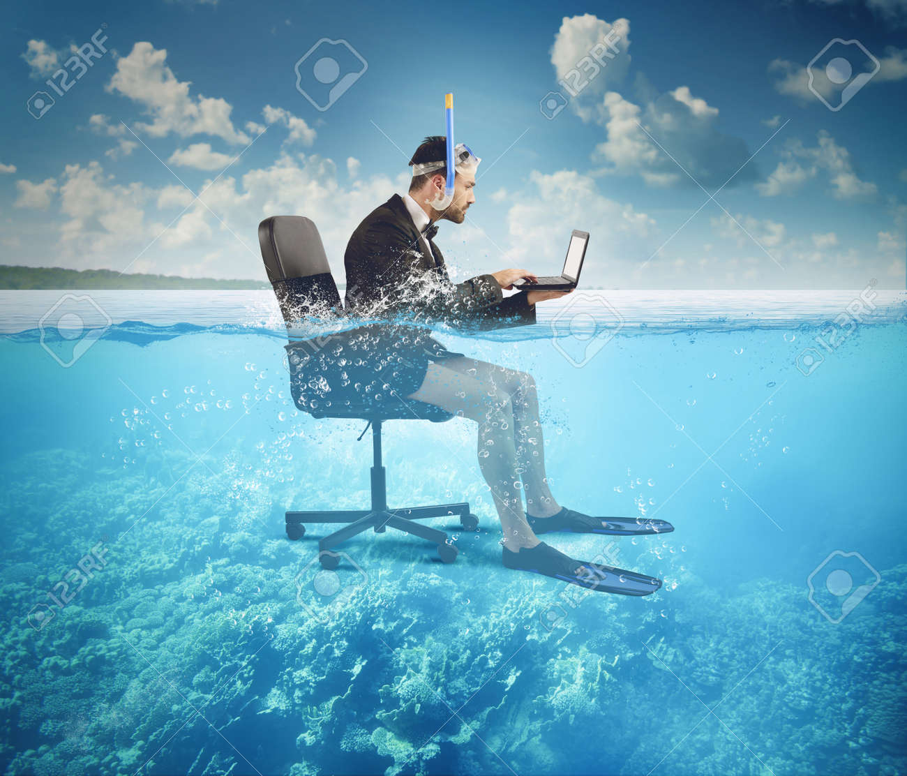 Businessman working on vacation even at sea - 34404654