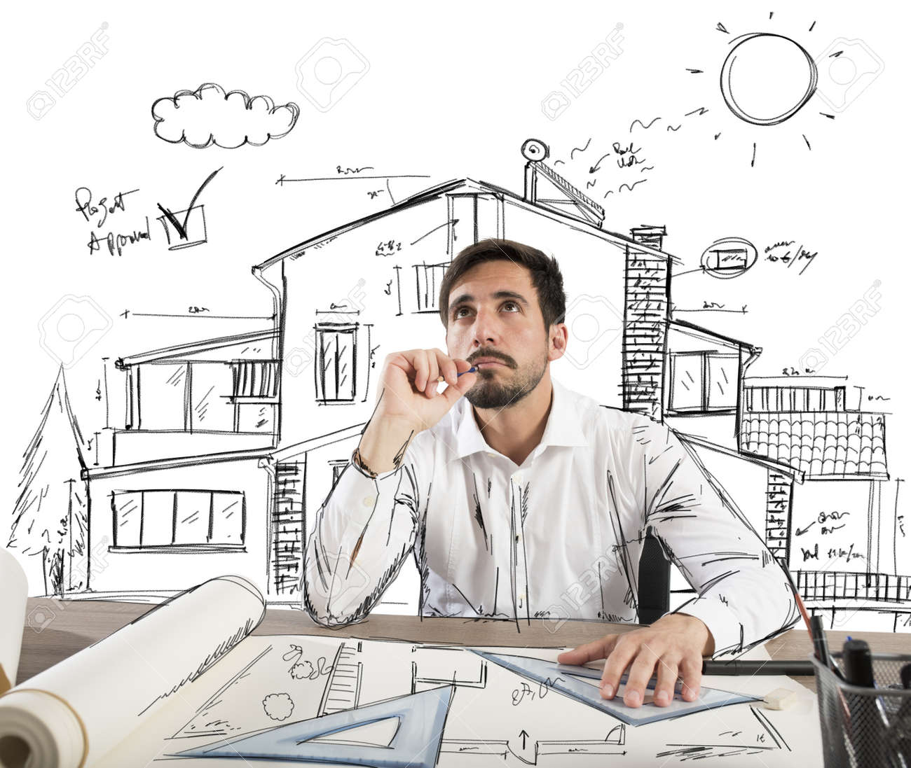 architect thinks how to design a house stock photo picture and