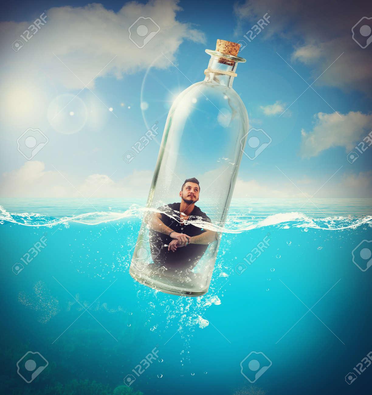 Boy travels in bottle in the ocean - 45607967