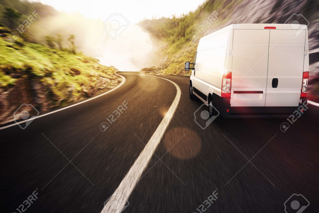 Truck on road in a natural landscape - 52445543