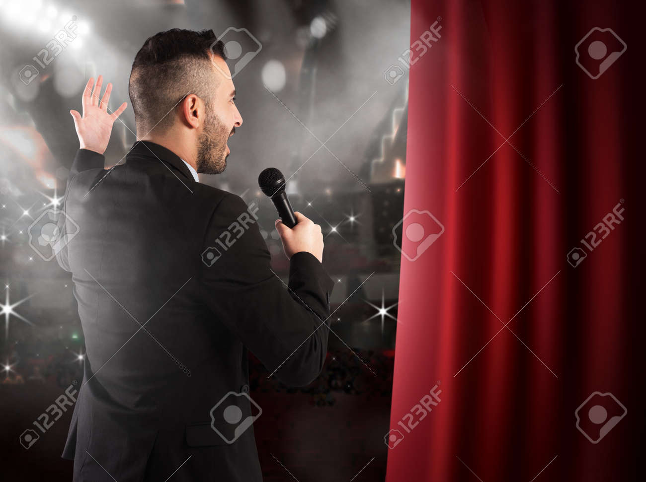 Man talking on microphone on theater stage Standard-Bild - 55096446