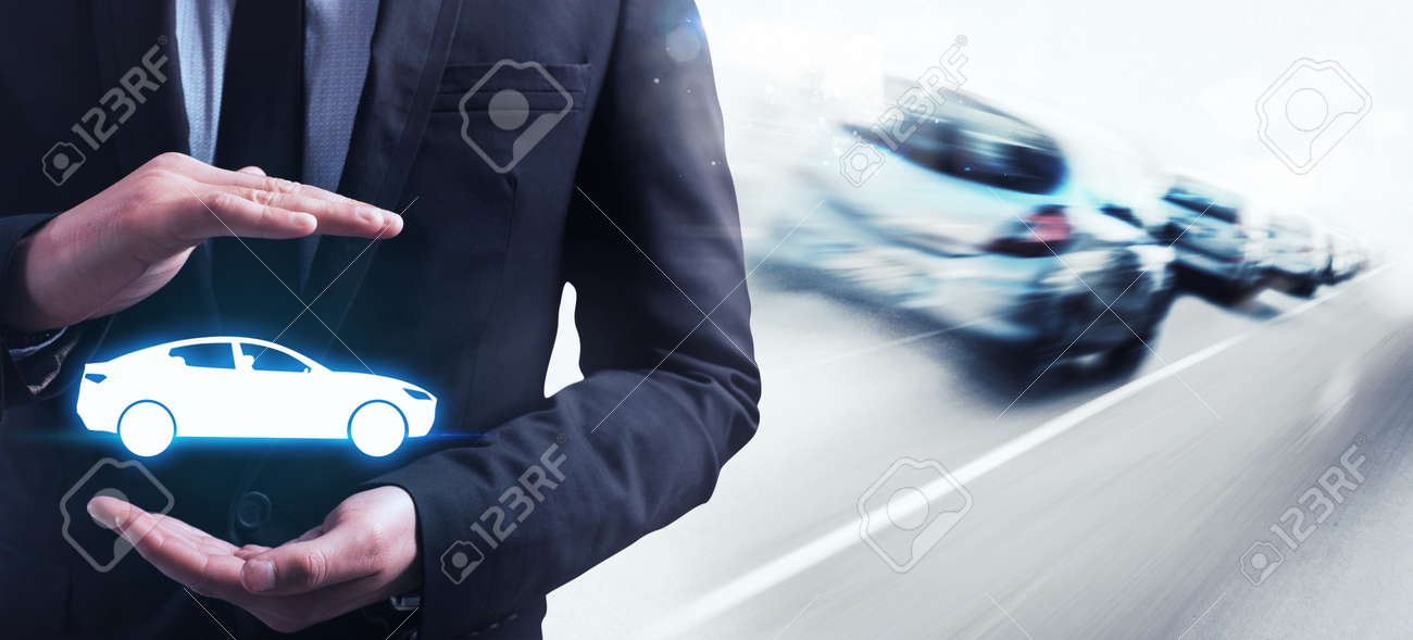 Man holds in his hands a car Standard-Bild - 55096509