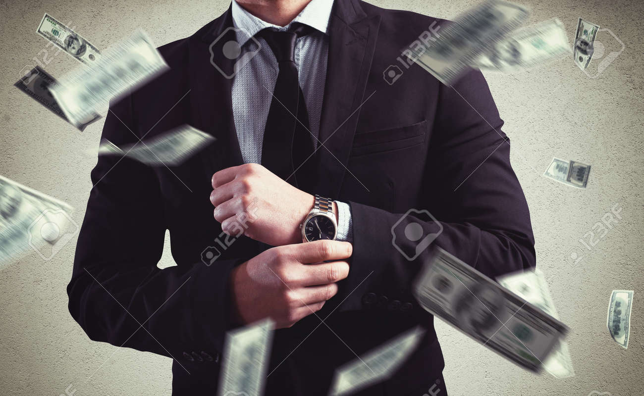 Rich Man with Clock and money background Standard-Bild - 56470691