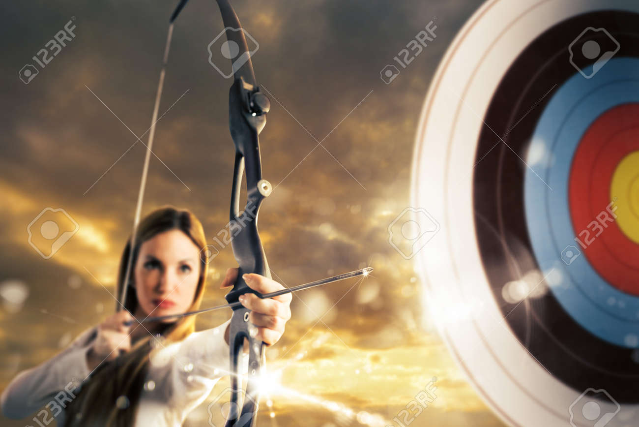 Woman with bow and arrow aiming a target Standard-Bild - 59132373