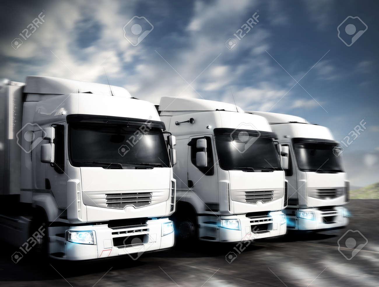 Three white articulated trucks on the road Standard-Bild - 58409557