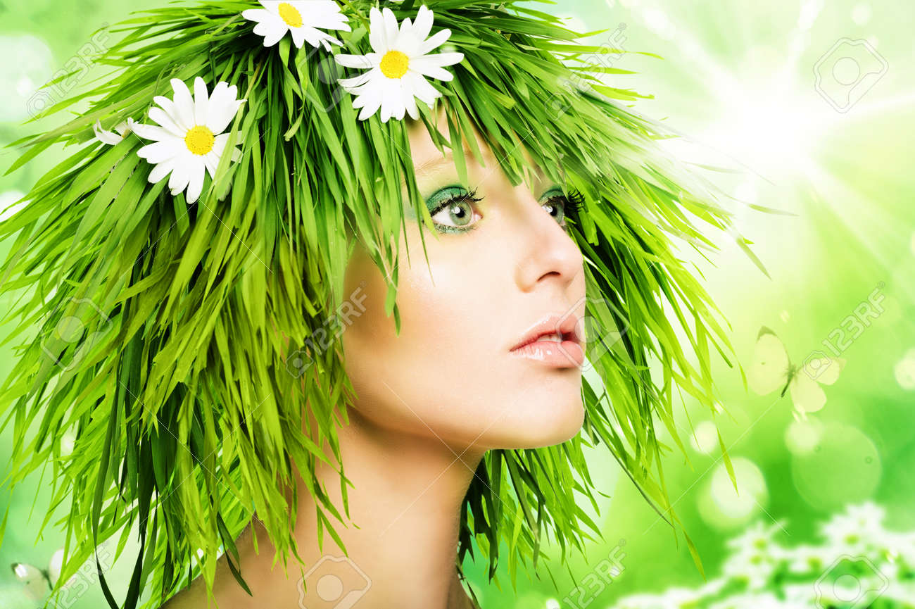 Girl with grass hair and green makeup - 60365627