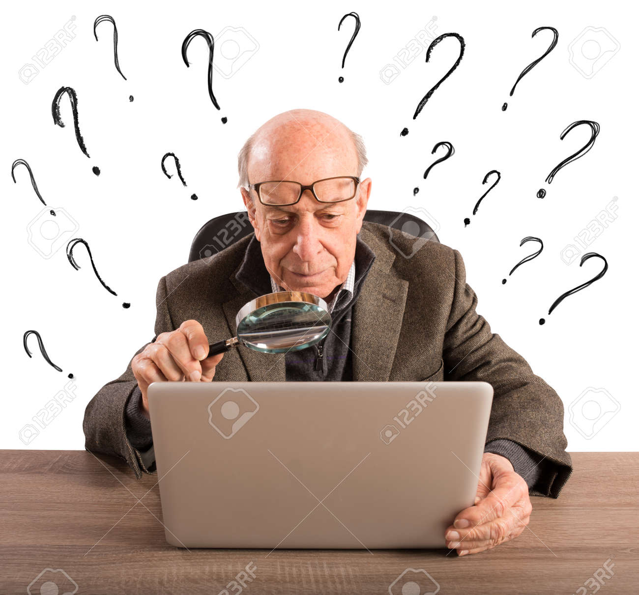 Confused elderly man looks at the computer Standard-Bild - 60366931