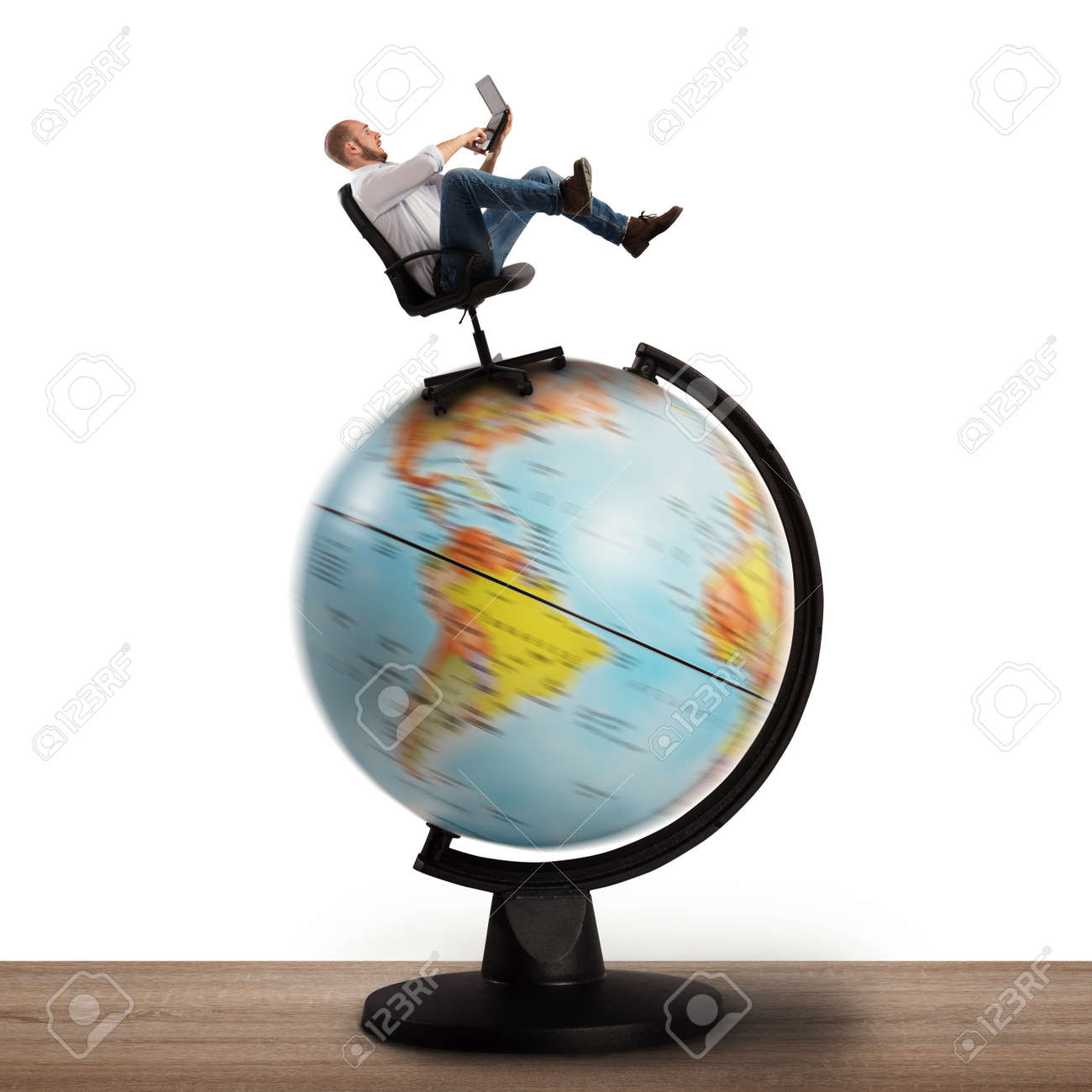 man at computer over a globe spinning stock photo picture and