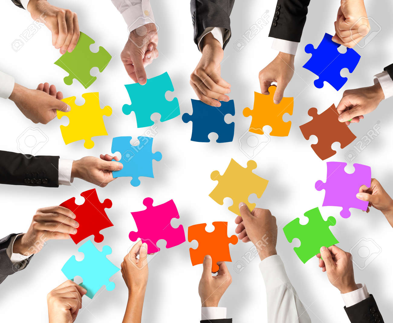 Business people join the colorful puzzle pieces. Concept of teamwork and integration Standard-Bild - 62101476