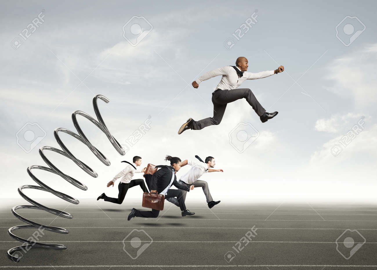 Businessman jumping on a spring during a race with opponents Standard-Bild - 64803531