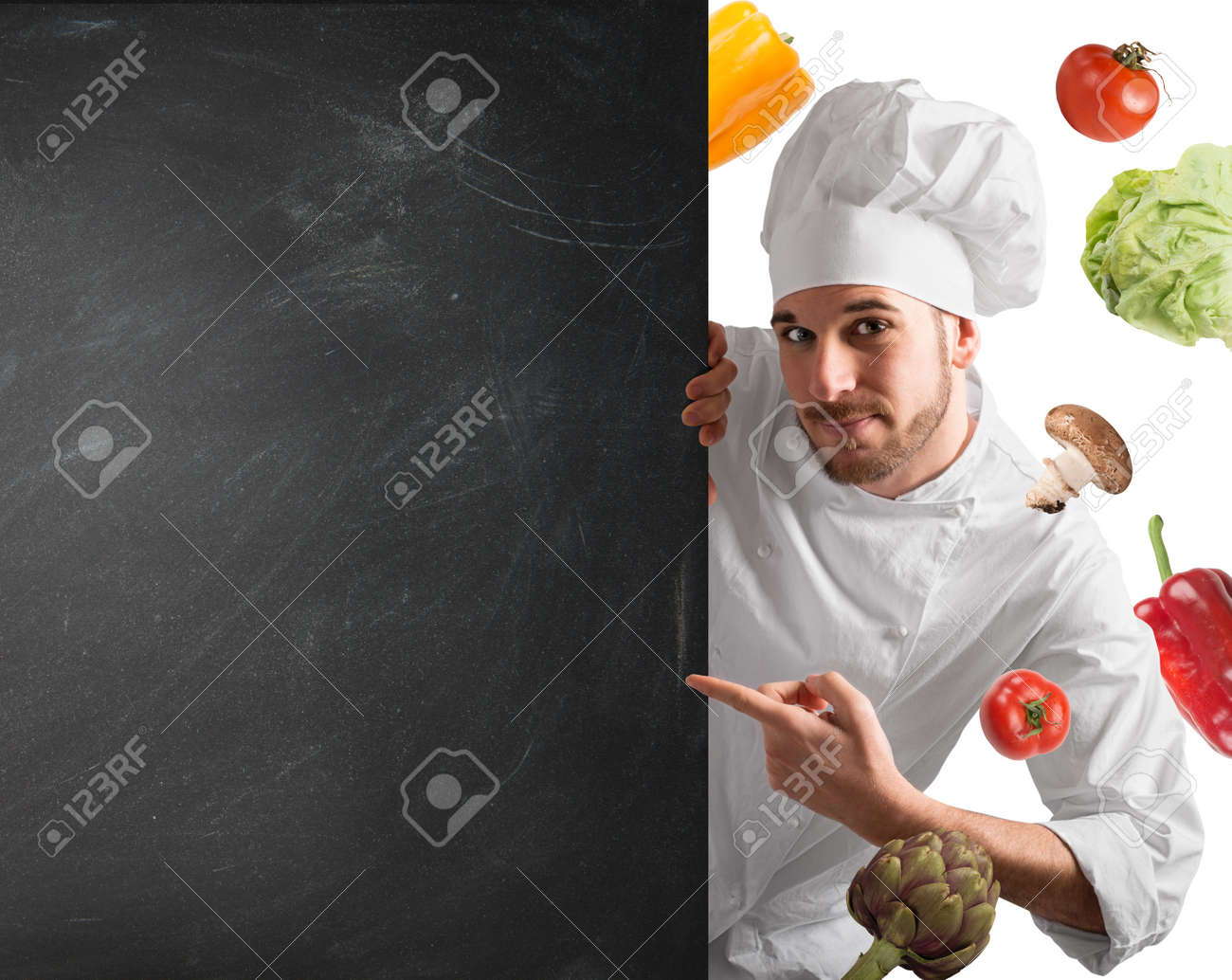Smiling chef with blackboard and vegetables background - 63888852