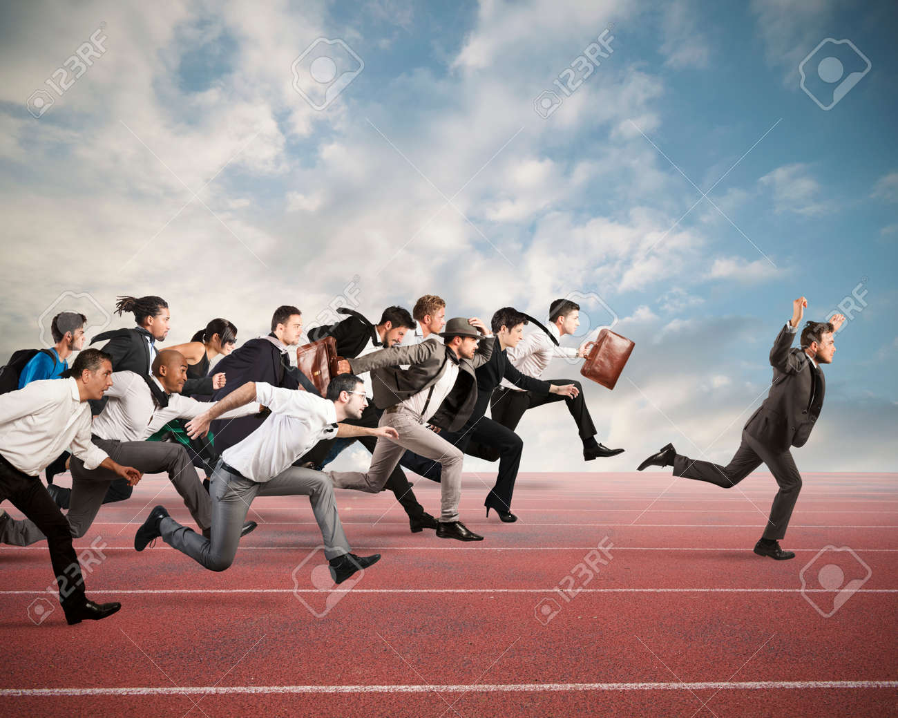 Businessman exults winning during a race with opponents Standard-Bild - 64803658