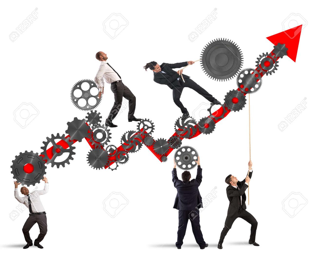 Teamwork build an arrow upwards with gears mechanism Standard-Bild - 64965834