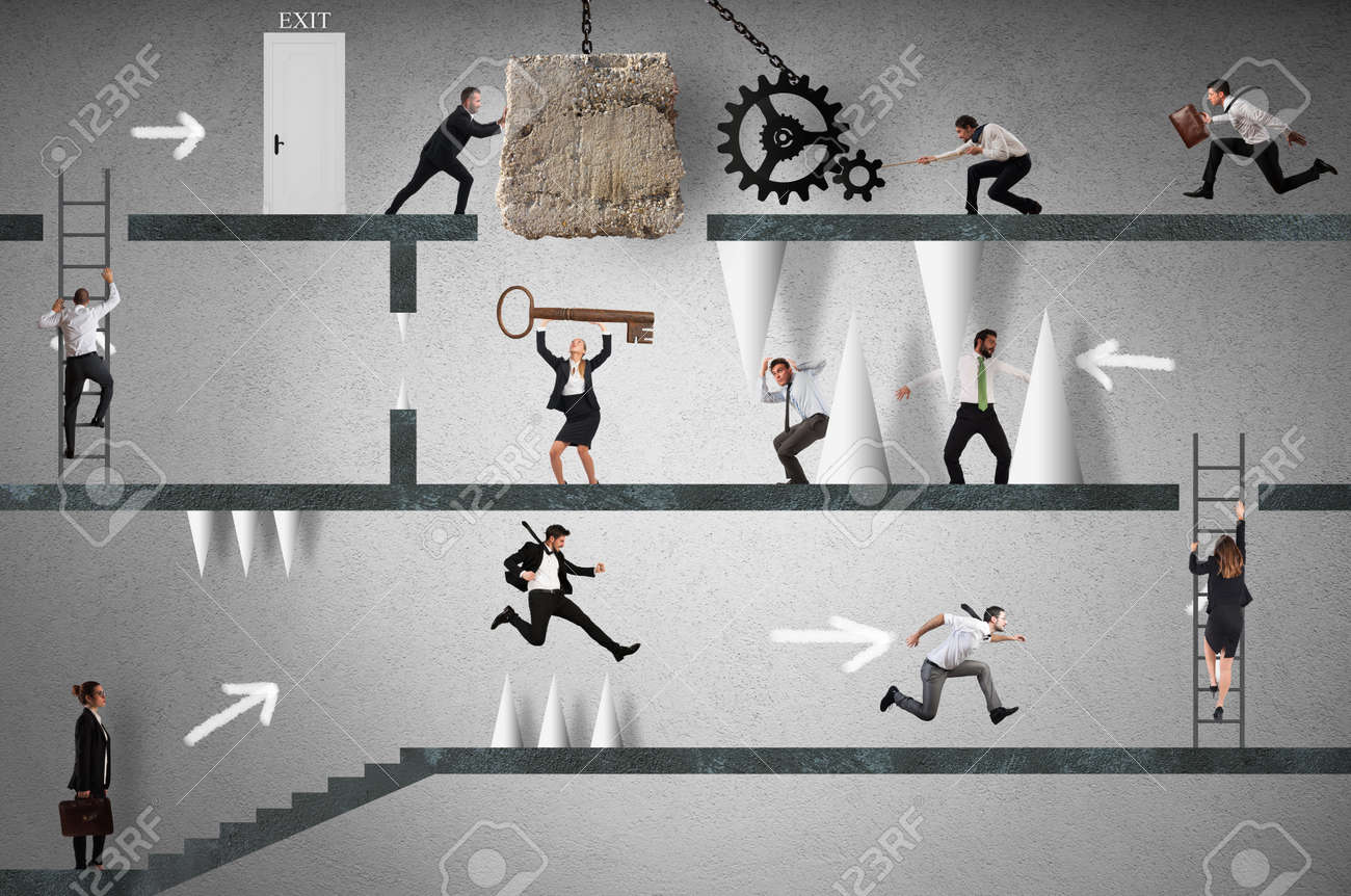Business people trying to make an obstacle path. career with obstacles concept Standard-Bild - 65114198