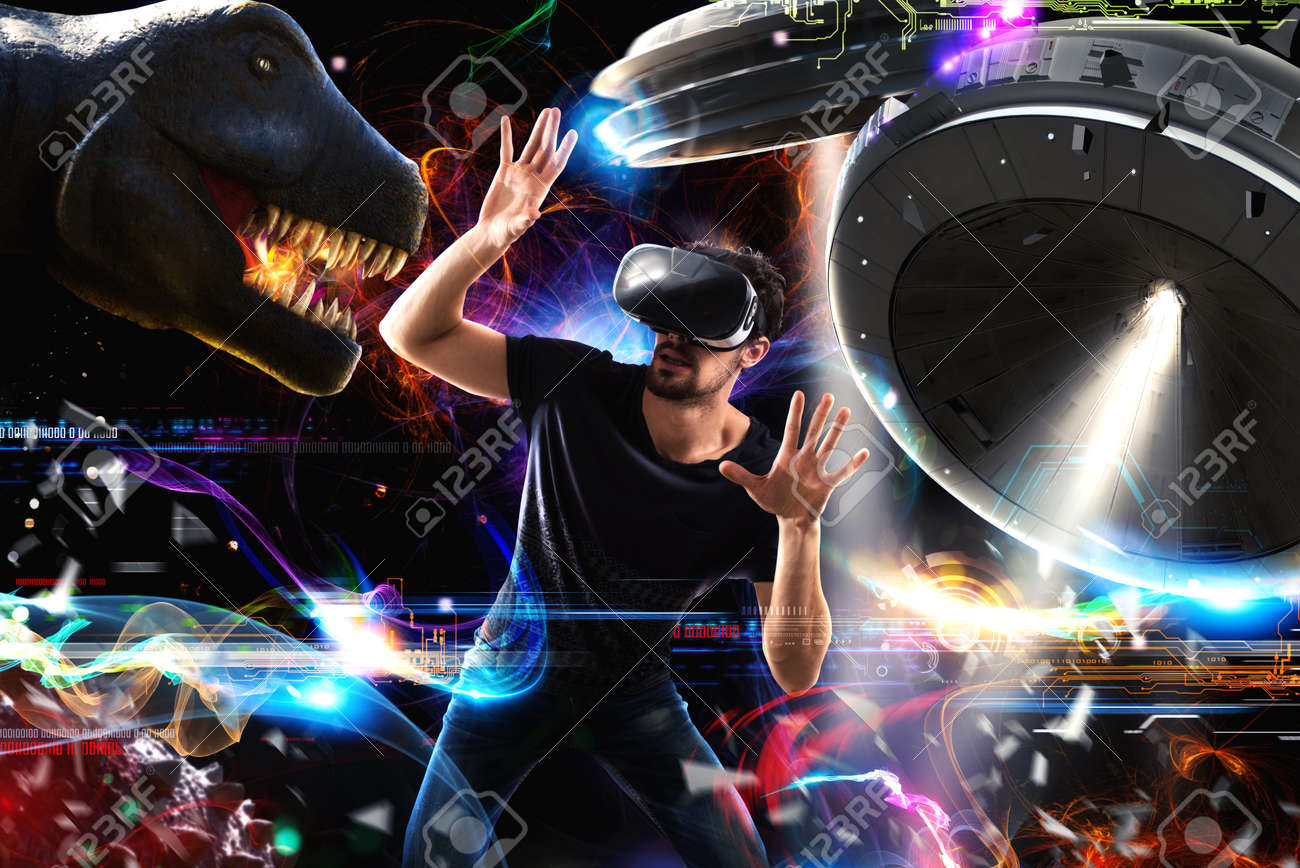 Man with 3D glasses plays with video games Standard-Bild - 68624859