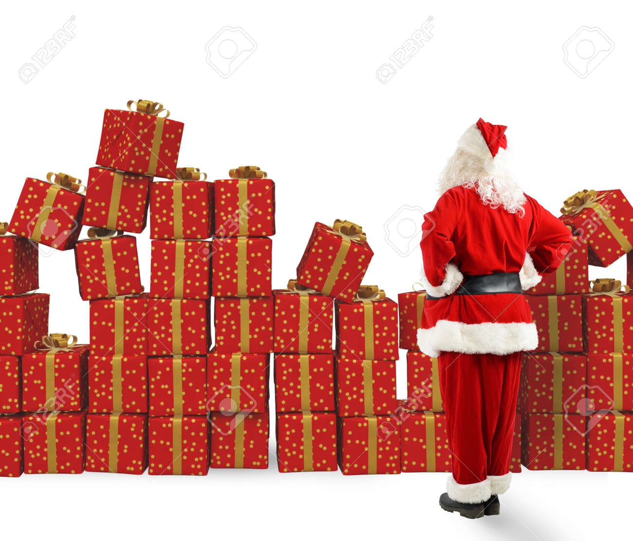 santa claus looks piles of christmas gifts stock photo 66762085