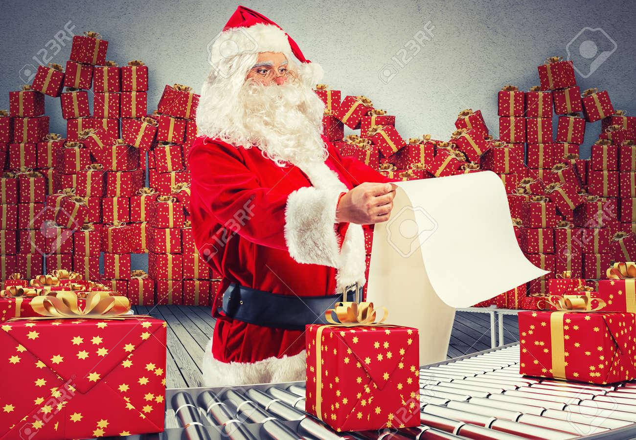 3d rendering santa claus checking on list xmas gift boxes and 3d rendering santa claus checking on list xmas gift boxes and wrapped on conveyor roller stock negle Choice Image