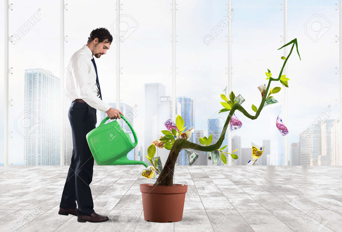 Businessman watering money coins as if they were plants Standard-Bild - 66484689
