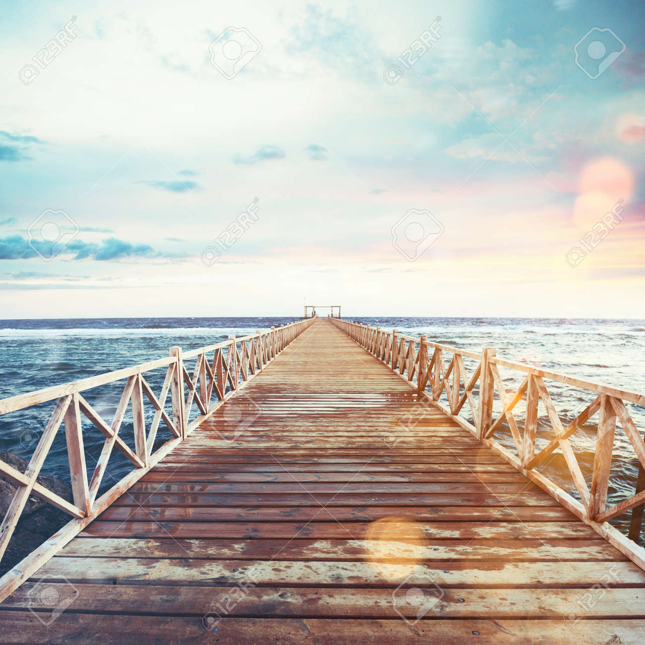 Pier on the sea at sunset - 82823747