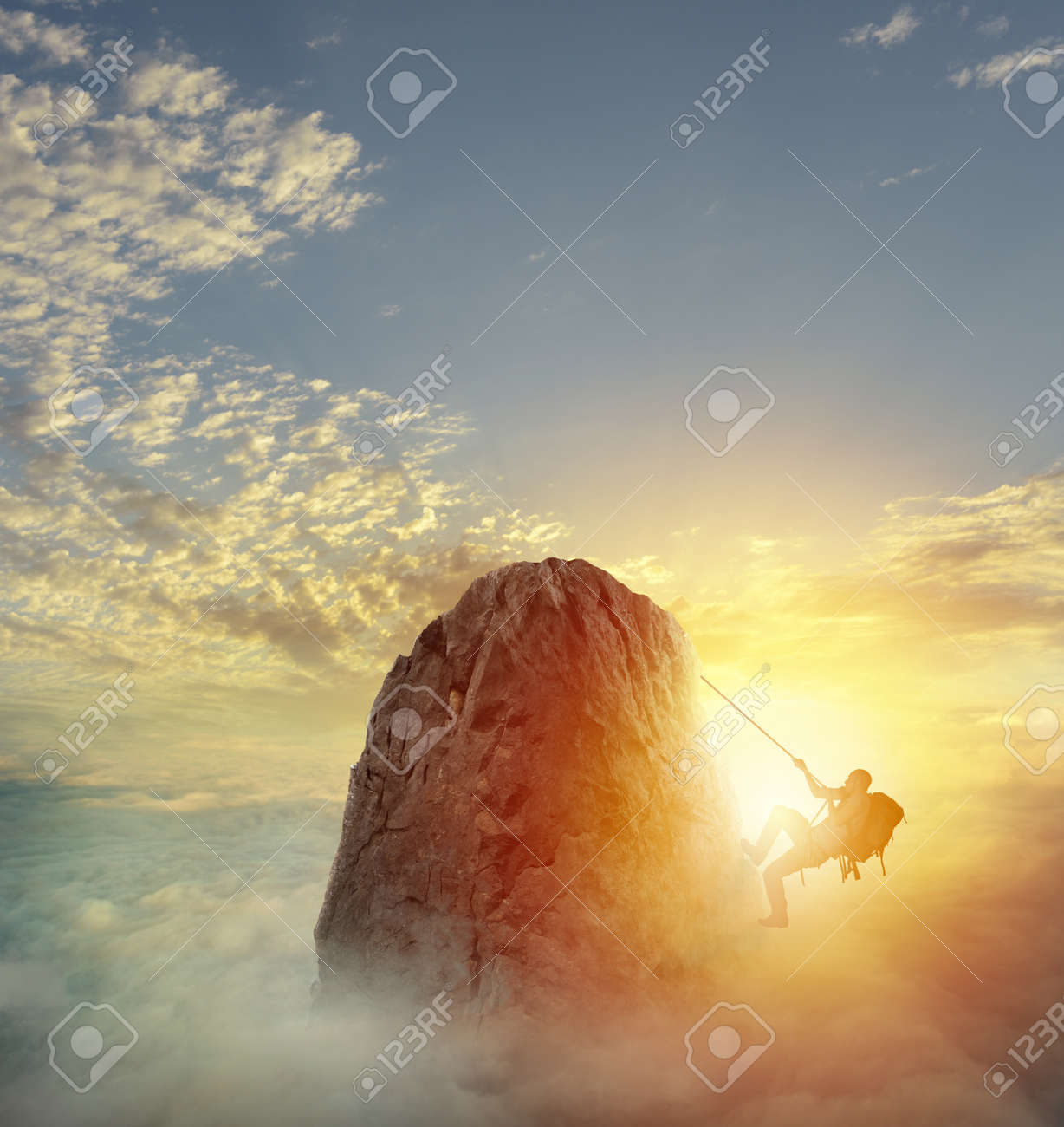 Businessman climb a mountain to get the flag. Achievement business goal and difficult career concept - 84939466