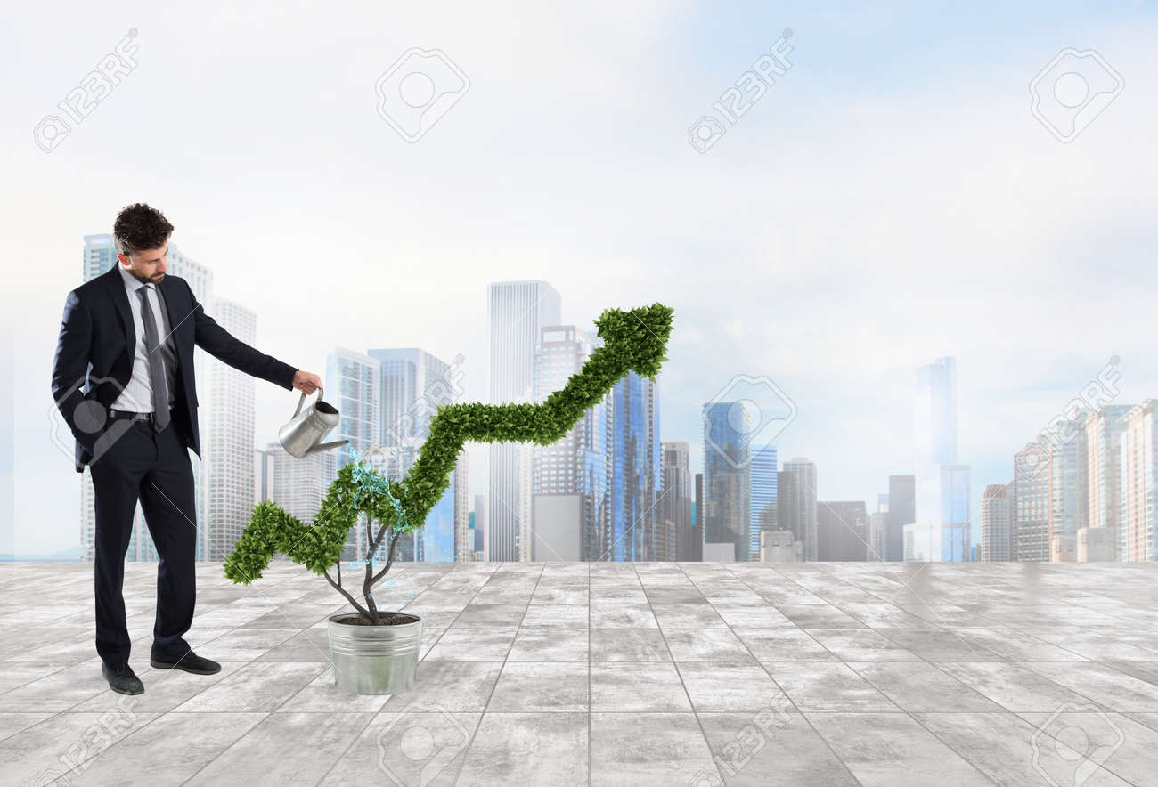 Businessman that watering a plant with a shape of arrow. Concept of growing of company economy . - 85244940