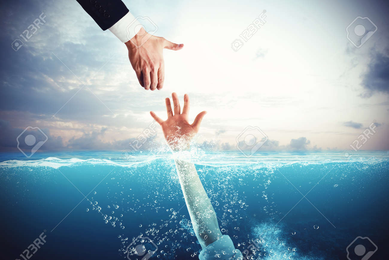 Business man tends his hand to save a person drowning - 88648056