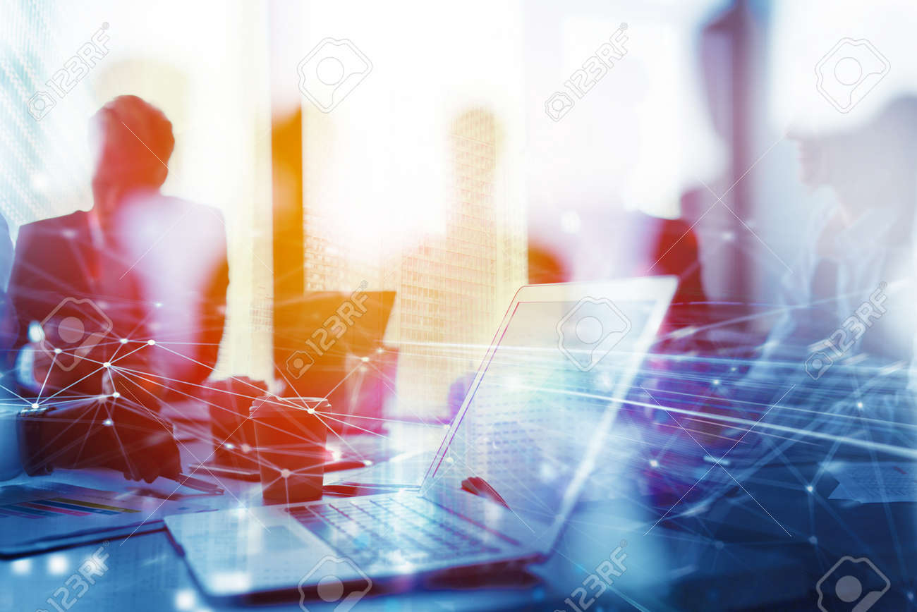 Teamwork works with a laptop. Concept of internet sharing and interconnection. double exposure - 88748213
