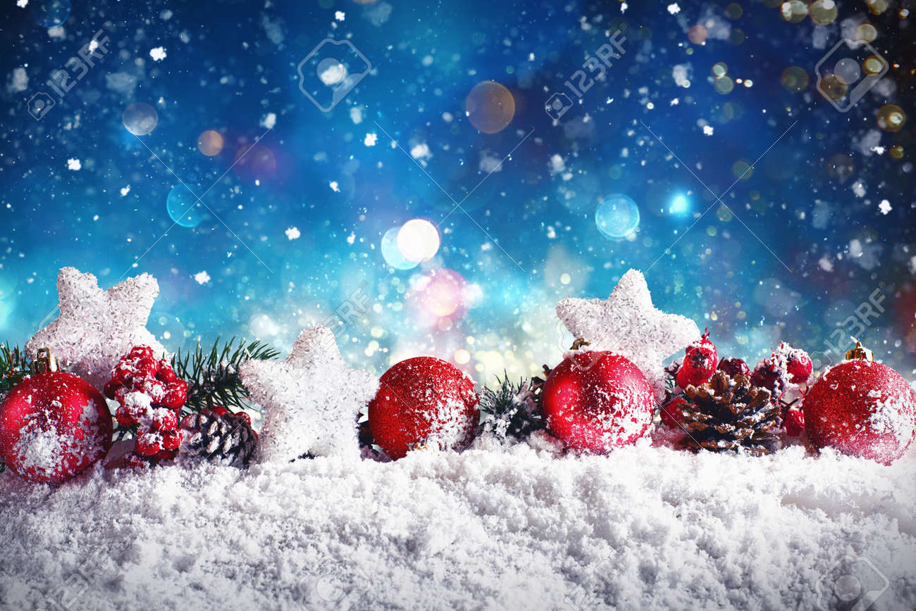 Christmas composition with balls,stars and garlands on snow with night light - 89249642