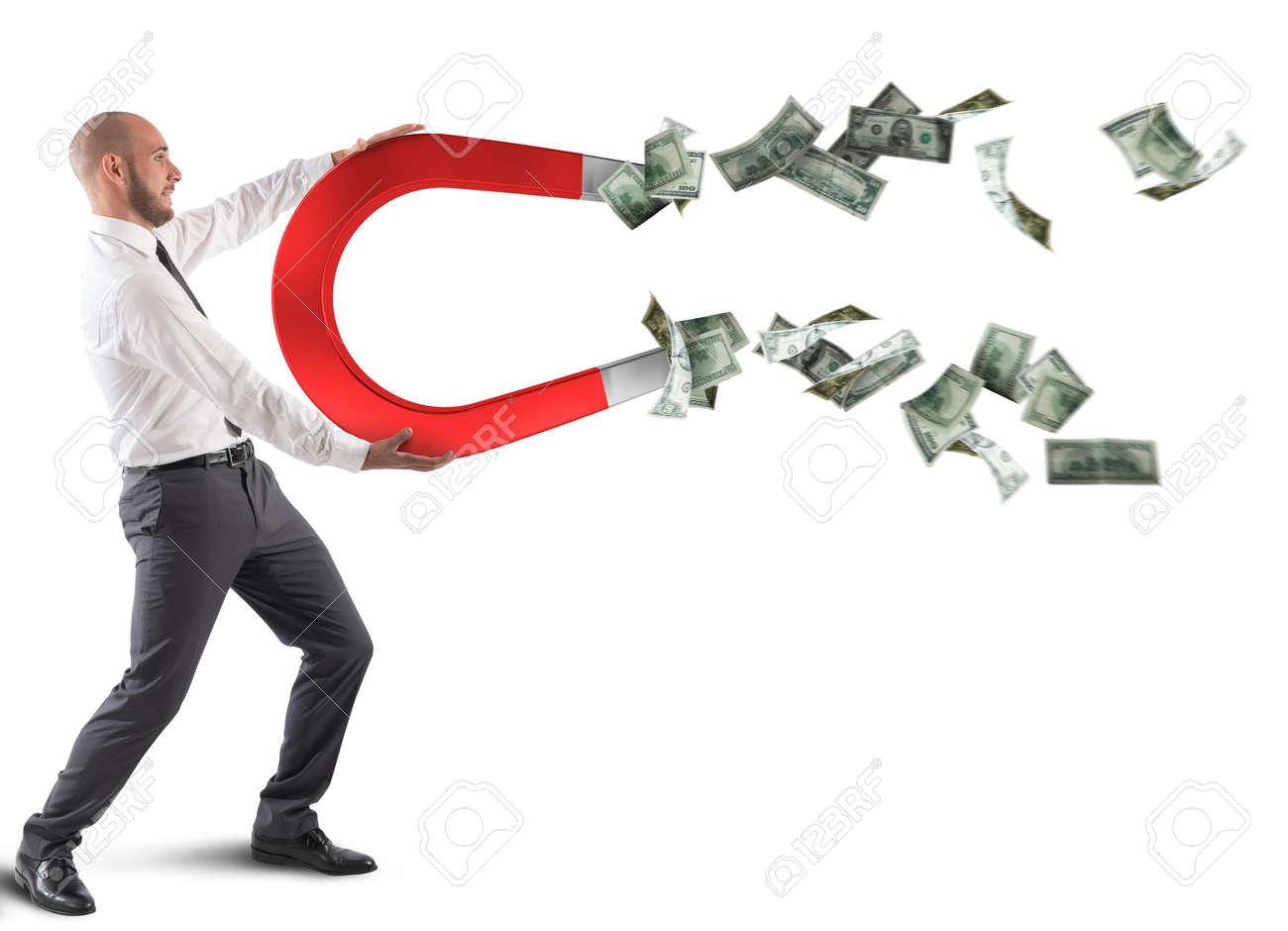 Businessman attracts money - 90613119