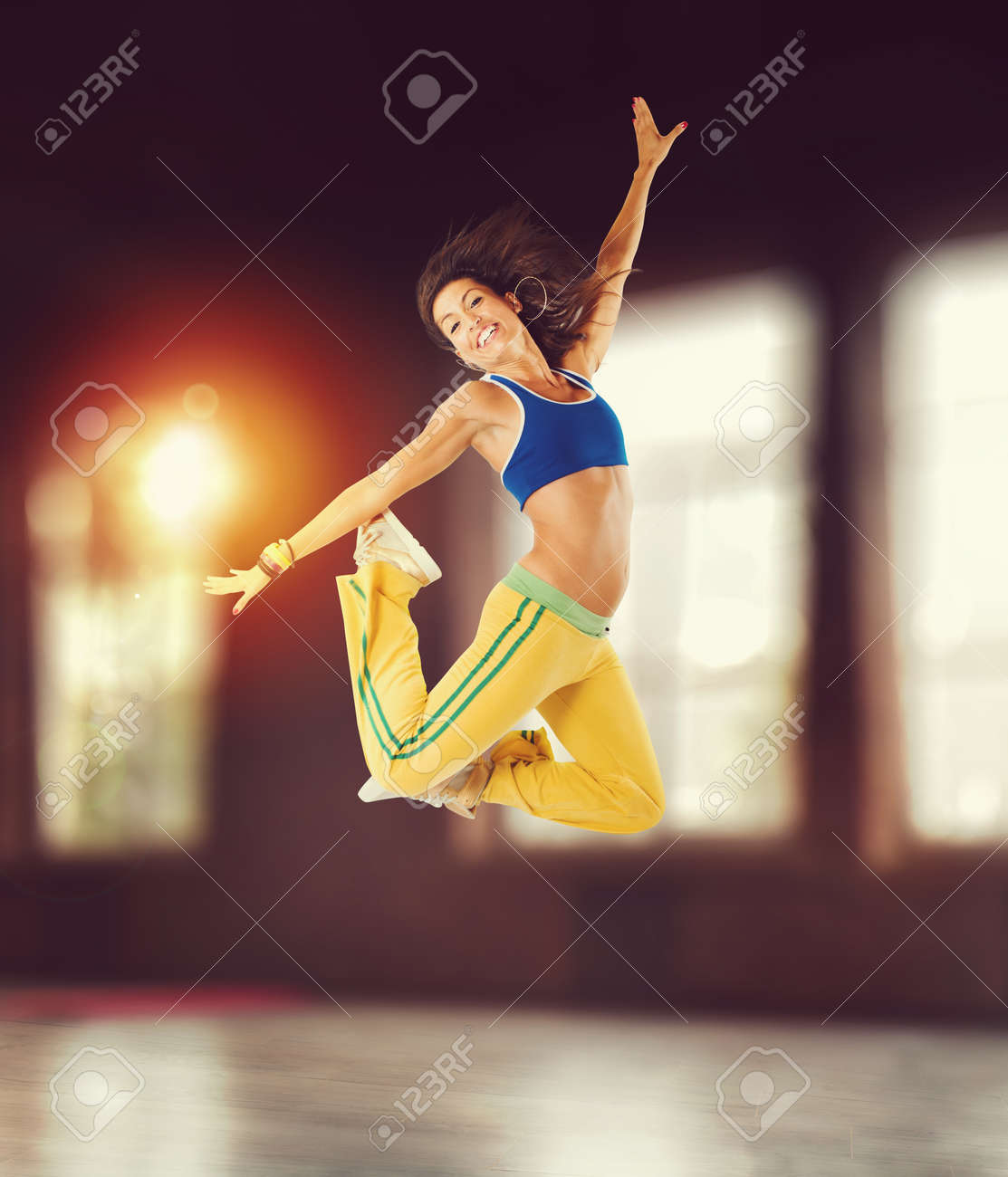 Happy girl has fun during the workout - 94753250