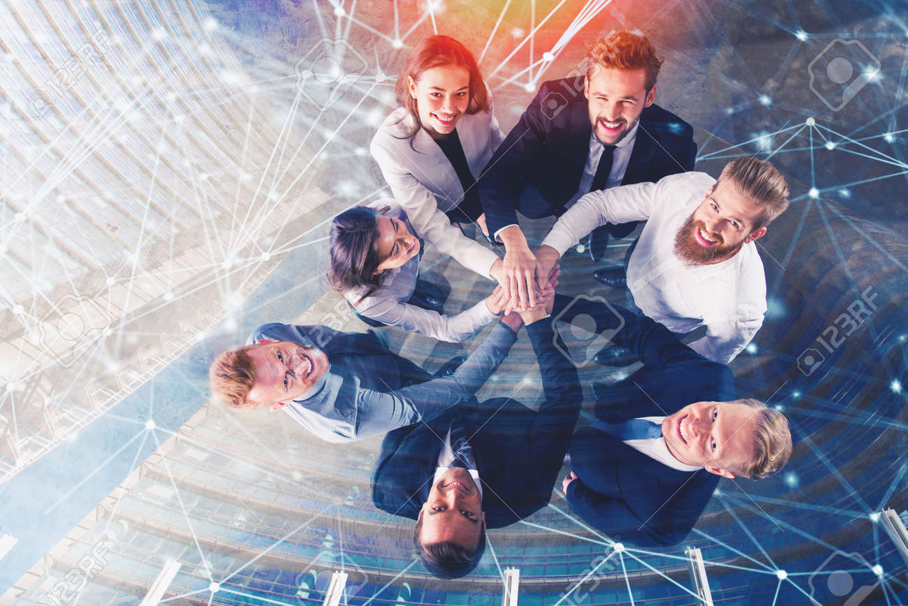 Business people putting their hands together with internet network effects. Concept of integration, teamwork and partnership. double exposure - 99898021