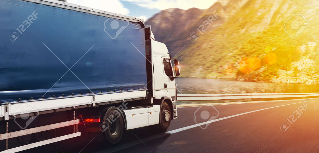 Truck run fast on the highway to deliver - 100148344