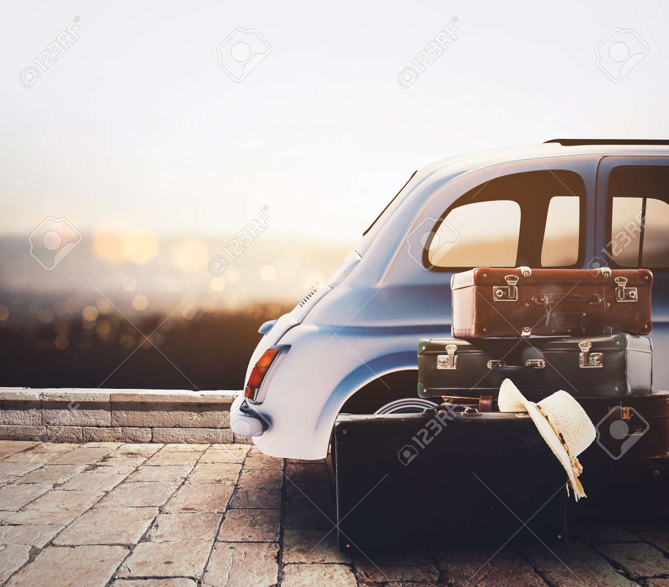 Car on the road ready for summer holiday during sunset with luggage - 107732721