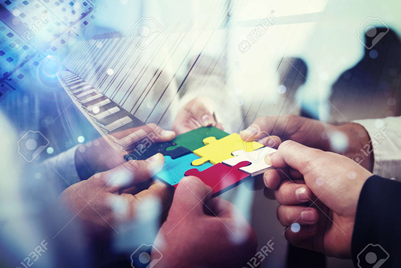 Business people join puzzle pieces in office. Concept of teamwork and partnership. double exposure with light effects - 109826206