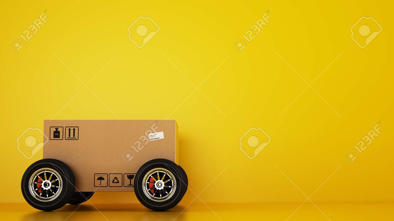 Cardboard box with racing wheels like a car on a yellow - 130218700
