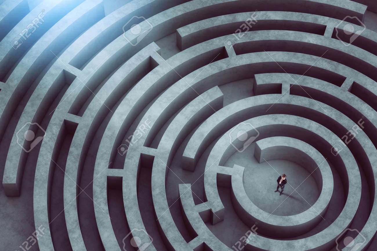Confused businessman thinks how to find the right way to exit from a big maze - 155184594