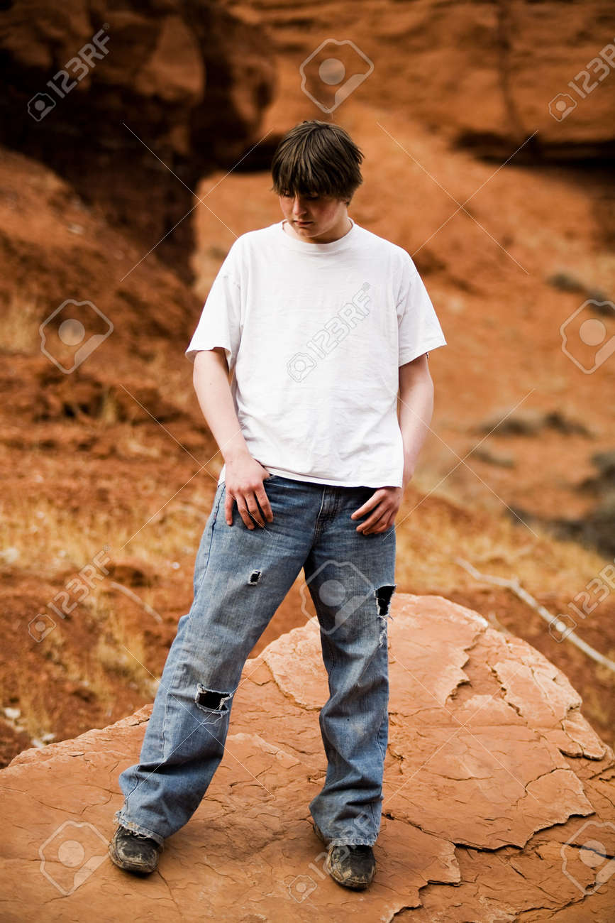 Teen in nature, in wilderness area standing on large flat rock Stock Photo - 3008320