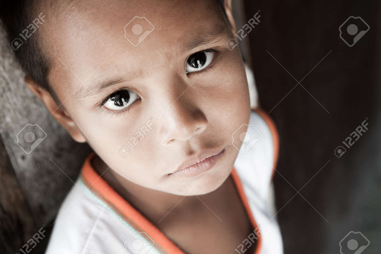 Portrait of a Filipino boy living in poverty - natural light - Manila, Philippines. Stock Photo - 9102576