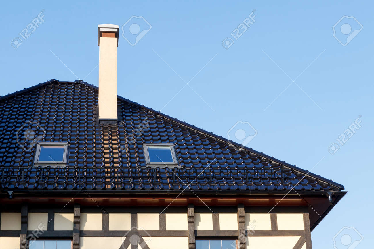 Roof of black glazed ceramic tiles with dormer windows and roof of black glazed ceramic tiles with dormer windows and ventilation pipe stock photo 69570273 dailygadgetfo Choice Image