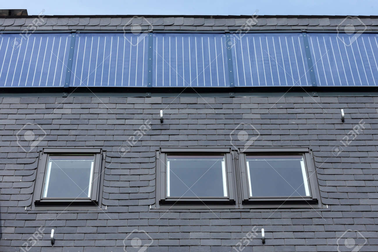 Roof Of Black Slate Tiles, Roof Windows And Fixed Solar Panels Stock ...