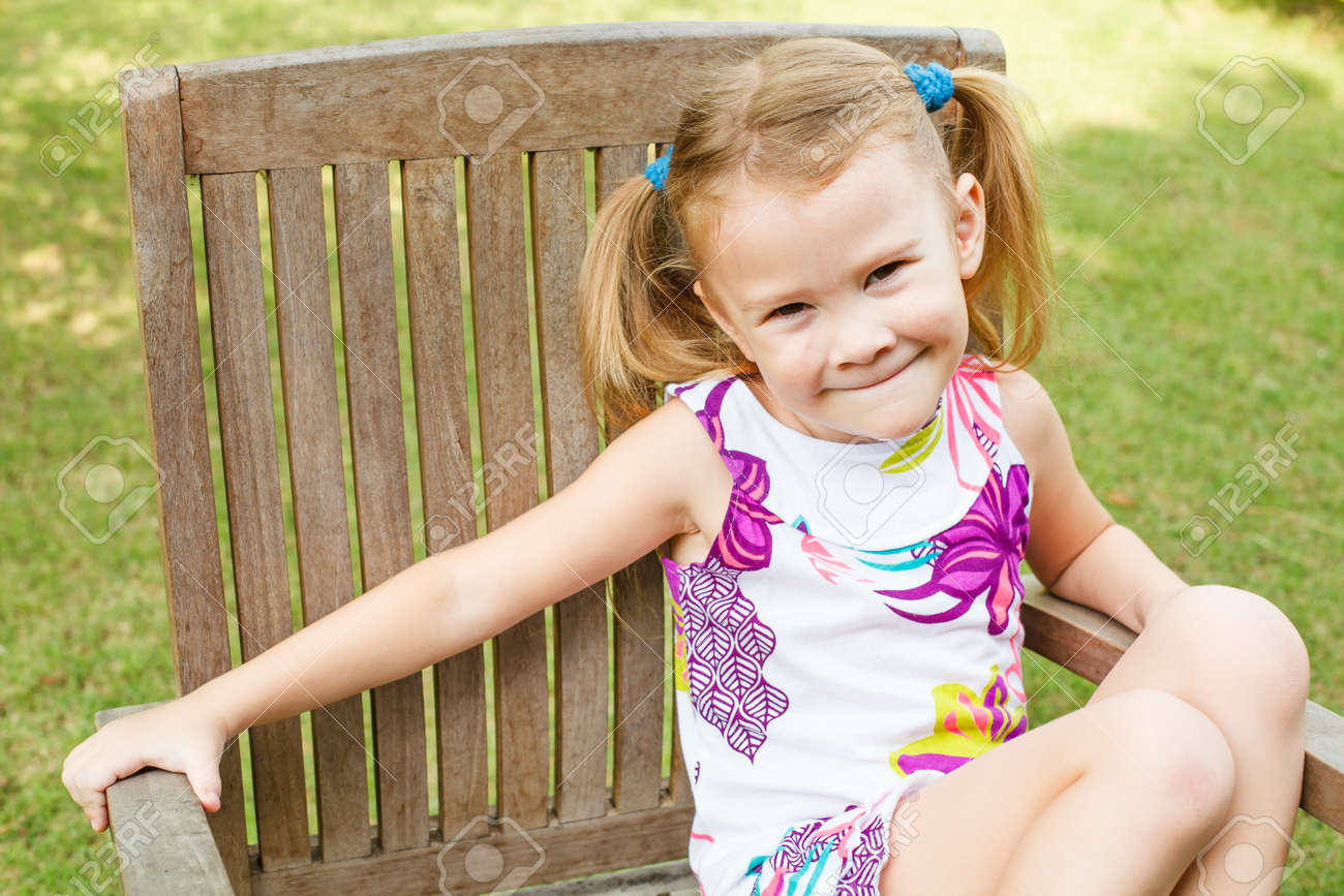 happy girl sitting on a chair in the garden Stock Photo - 16748961