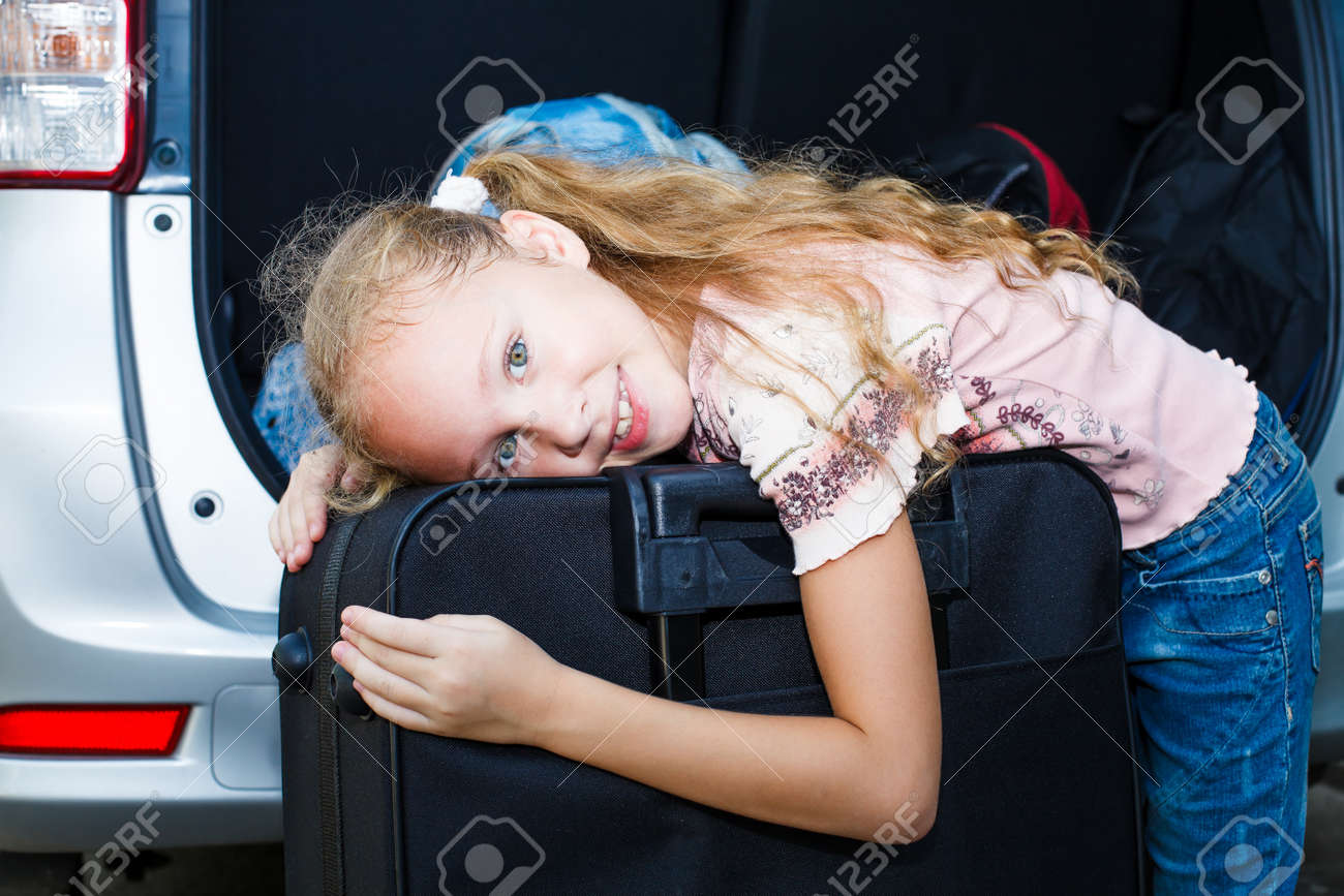 little girl standing near the car with backpacks Stock Photo - 16890936