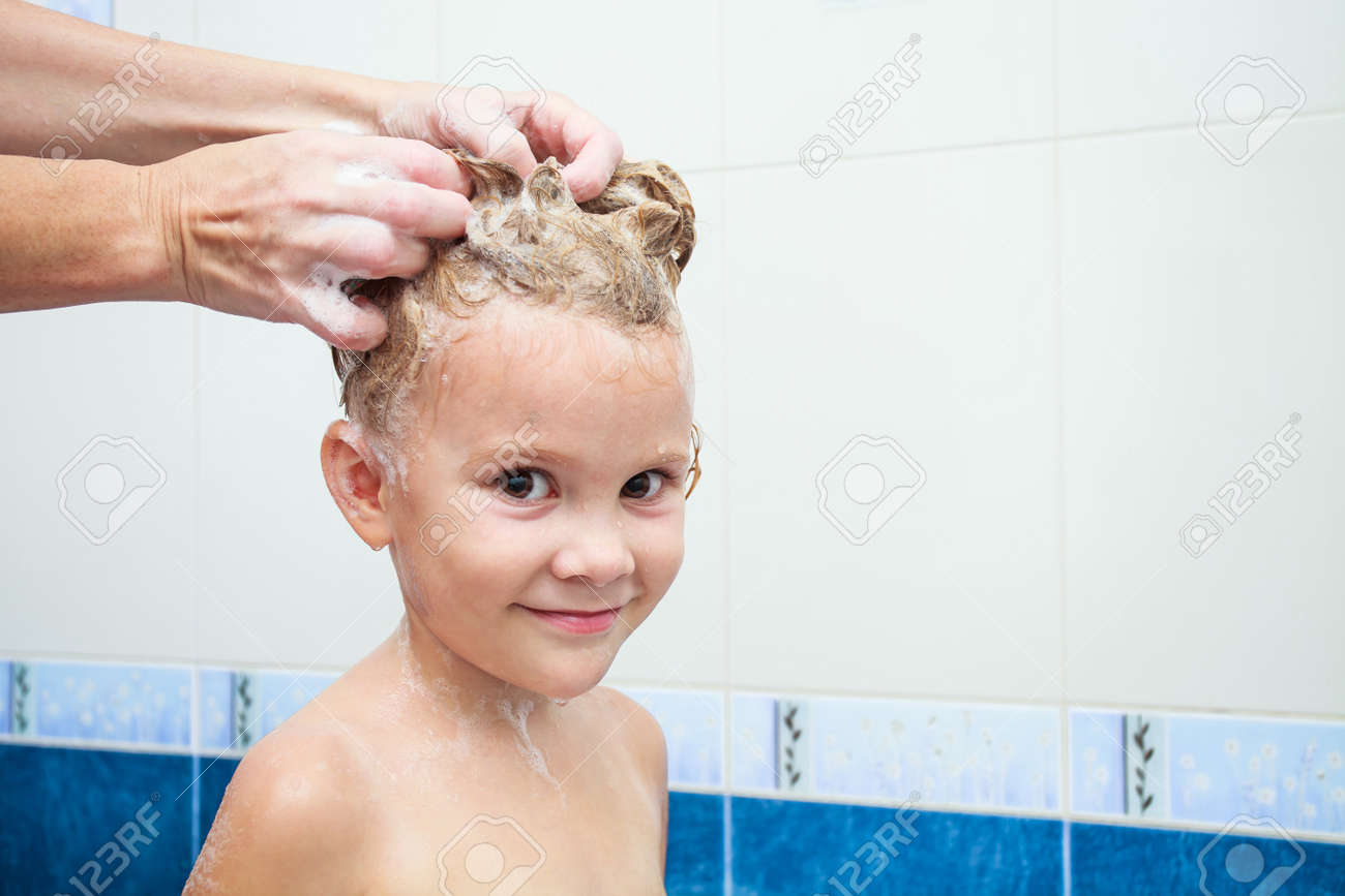 Cute four year old girl taking a relaxing bath with foam Stock Photo - 16907680